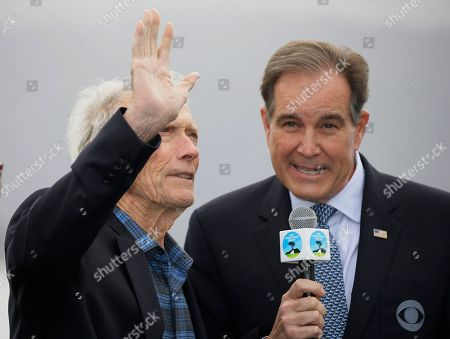 Clint Eastwood, Jim Nantz. Clint Eastwood waves on the 18th green of the Pebble Beach Golf Links as Jim Nantz, right, looks on during the awards ceremony of the AT&T Pebble Beach National Pro-Am golf tournament, in Pebble Beach, Calif