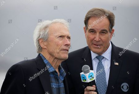 Clint Eastwood, Jim Nantz. Clint Eastwood on the 18th green of the Pebble Beach Golf Links as Jim Nantz, right, looks on during the awards ceremony of the AT&T Pebble Beach National Pro-Am golf tournament, in Pebble Beach, Calif