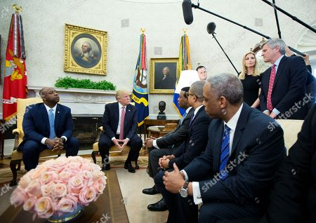 Donald Trump, Tim Scott, Ivanka Trump, Steve Case. President Donald Trump, with Sen. Tim Scott, R-S.C., left, and Ivanka Trump, top second from right, listens to Steve Case, top right, talks during a working session regarding the opportunity zones provided by tax reform in the Roosevelt Room of the White House, in Washington