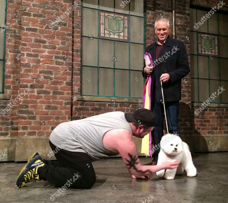 "Stock Picture of Flynn, Bill McFadden, Daniel Stewart Sherman. Actor Daniel Stewart Sherman kneels down to play with Westminster dog show winner Flynn the bichon frise as handler Bill McFadden watches from right, before Flynn did a walk-on part at the Broadway musical ""Kinky Boots"" in New York"