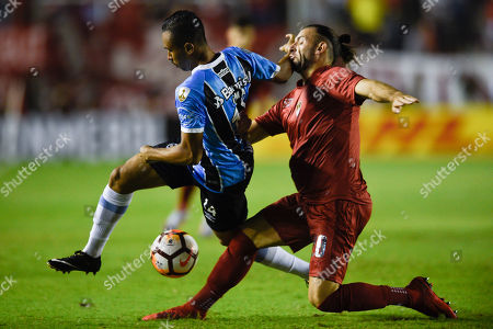 Vinicius Lima of Brazil's Gremio, left, fights for the ball with Gaston Silva of Argentina's Independiente during a Recopa Sudamericana first leg final soccer match in Buenos Aires, Argentina