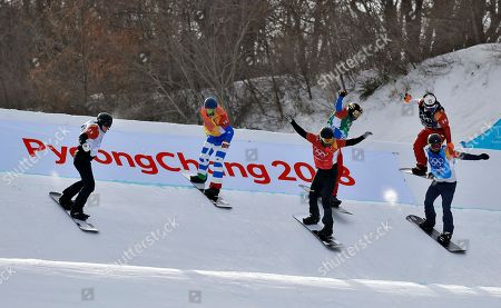From left; Mick Dierdorff, of the United States, Paul Berg, of Germany, Regino Hernandez, of Spain, Hagen Kearney, of the United States, Christopher Robanske, of Canada, and Loan Bozzolo, of France, run the course during the men's snowboard cross quarterfinals at Phoenix Snow Park at the 2018 Winter Olympics in Pyeongchang, South Korea