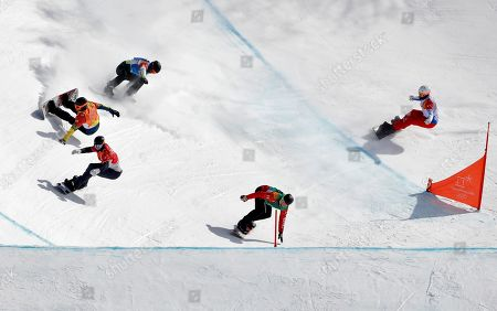 From left; Lluis Marin Tarroch, of Andorra, crashes as Hagen Kearney, of the United States, Adam Lambert, of Australia, Christopher Robanske, of Canada, and Loan Bozzolo, of France, run the course during the men's snowboard cross elimination round at Phoenix Snow Park at the 2018 Winter Olympics in Pyeongchang, South Korea
