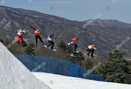 From left; Loan Bozzolo, of France, Christopher Robanske, of Canada, Adam Lambert, of Australia, Hagen Kearney, of the United States, and Lluis Marin Tarroch, of Andorra, run the course during the men's snowboard cross elimination round at Phoenix Snow Park at the 2018 Winter Olympics in Pyeongchang, South Korea