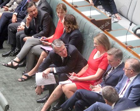 "Australia's opposition lawmaker Mark Dreyfus, center, sits with colleagues during a session in the Australian Parliament in Canberra, . Dreyfus told the Parliament that the ministerial code of conduct stated that ministers ""must not seek or encourage any form of gift in their personal capacity"" while calling for the dismissal of Deputy Prime Minister Barnaby Joyce"