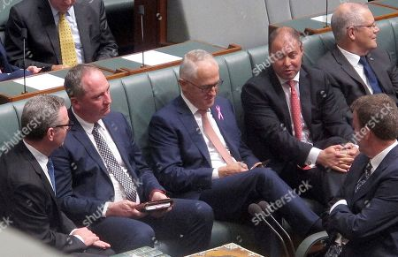 Branaby Joyce, Malcolm Turnbull. Australian Deputy Prime Minster Barnaby Joyce, second from left, sits with colleagues including Prime Minister Malcolm Turnbull, center, during a session in the Australian Parliament in Canberra, . Joyce survived a Parliamentary vote that threatened his political career after the opposition Labor Party called on Turnbull to fire his deputy for breaching standards of behavior demanded of government ministers