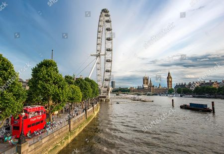 Stock Picture of View over the Thames from Golden Jubilee Bridge, promenade with Ferris wheel London Eye, at the back Big Ben and Houses of Parliament, London, England, Great Britain