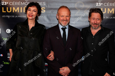 """Stock Image of Jeanne Balibar, photo director Christophe Beaucarne and Mathieu Almaric pose during a photocall prior to the 23rd Lumieres awards ceremony at the """"Institut du Monde Arabe"""" in Paris, . The Academie des Lumieres, is a group of 200 foreign journalists who reunite each year in Paris to vote for the best French films"""