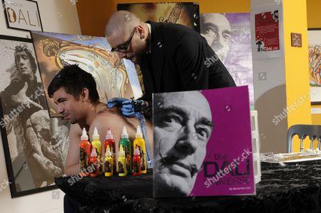 Stock Picture of Salvador Dali Fan, Richard with Tattooist Dan Gold