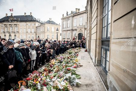 People lay flowers in tribute of late Danish Prince Consort Henrik in front of Amalienborg Palace in Copenhagen, Denmark, 15 February 2018. Prince Henrik of Denmark has died in his sleep at Fredensborg Palace on the evening of 13 February 2018. The funeral service of the 83-year-old French-born prince will be held at Christiansborg Palace Church (Christiansborg Slotskirke) at Slotsholmen in Copenhagen on 20 February 2018 and will be a private ceremony for family and friends as per his request.