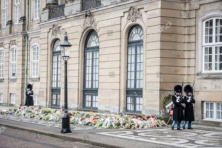 Flowers in tribute of late Danish Prince Consort Henrik lay in front of Amalienborg Palace in Copenhagen, Denmark, 15 February 2018. Prince Henrik of Denmark has died in his sleep at Fredensborg Palace on the evening of 13 February 2018. The funeral service of the 83-year-old French-born prince will be held at Christiansborg Palace Church (Christiansborg Slotskirke) at Slotsholmen in Copenhagen on 20 February 2018 and will be a private ceremony for family and friends as per his request.