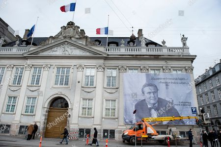 A giant portrait of late Danish Prince Consort Henrik is hung at the French Embassy in Copenhagen, Denmark, 15 February 2018.  Prince Henrik of Denmark has died in his sleep at Fredensborg Palace on the evening of 13 February 2018. The funeral service of the 83-year-old French-born prince will be held at Christiansborg Palace Church (Christiansborg Slotskirke) at Slotsholmen in Copenhagen on 20 February 2018 and will be a private ceremony for family and friends as per his request.