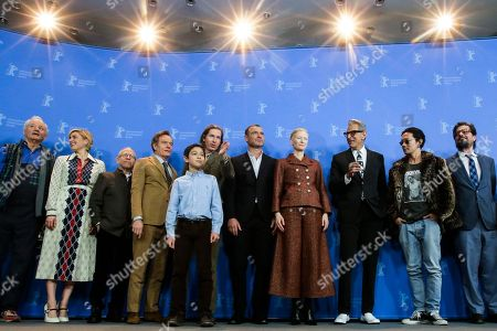 Bill Murray, Greta Gerwig, Bob Balaban, Bryan Cranston, Koyu Rankin, Wes Anderson, Liev Schreiber, Tilda Swinton, Jeff Goldblum, Kunichi Nomura and Roman Coppola, from left, pose for a photograph during a photo-call for the movie 'Isle of Dogs' during the 68th edition of the Berlinale Berlin Film Festival in Berlin, Germany