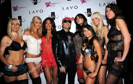 Stock Photo of Evan Seinfeld and Tera Patrick with models