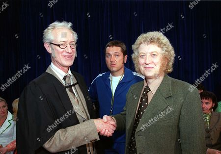 'The Grimleys' Series 2 -TV - 2000 -  This week Mr Neville Holder (Noddy Holder) is given the job of acting Deputy Head Teacher.  Will all the power go to his head? also pictured Headmaster [Bamber Gascoigne] and Doug Digby [Brian Conley]