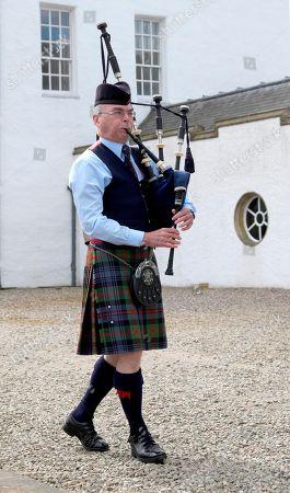 Stock Photo of Bagpipe player, Blair Castle, Blair Atholl, Perth and Kinross, Scotland, UK