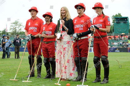 Team London before the start of their semi-final match against Team Moscow, with Jodie Kidd holding the trophy. From left to right:  Jack Kidd (No4), Henry Brett (No3), Jamie Morrison (No2) and Nina Clarkin (No1).