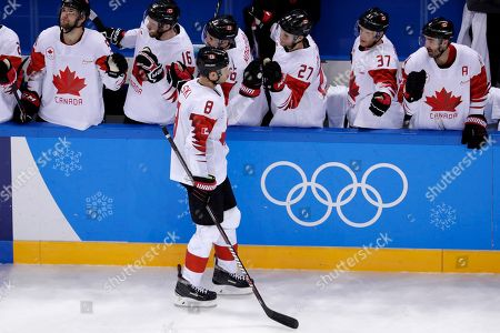 Wojtek Wolski (8), of Canada, celebrates with the bench after scoring a goal on Switzerland during the third period of a preliminary round men's hockey game at the 2018 Winter Olympics in Gangneung, South Korea, . Canada won 5-1
