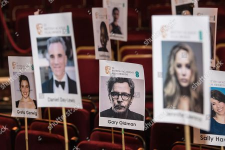 Photos of Greta Gerwig, Daniel Day Lewis, Gary Oldman, Jennifer Lawrence and other are arranged in the seating plan at London's Royal Albert Hall ahead of the EE British Academy Film Awards on Sunday 18th February