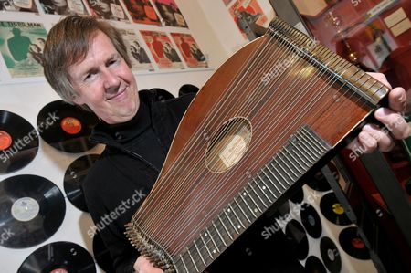Third Man Museum owner Gerhard Strassgschwandtner with the zither on which Anton Karas played the film score