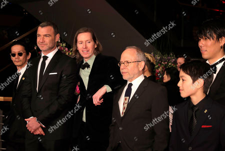 Kunichi Nomura, Liev Schreiber, Wes Anderson, Bob Balaban, Koyu Rankin and Yojiro Noda, from, left, talk as they arrive for the film 'Isle of Dogs' during the 68th edition of the International Film Festival Berlin, Berlinale, in Berlin, Germany