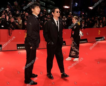 Yojiro Noda, Kunichi Nomura, and Mari Natsuki, from left, pose on the red carpet for the film 'Isle of Dogs' during the 68th edition of the International Film Festival Berlin, Berlinale, in Berlin, Germany