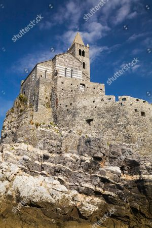 Medieval fortress walls and church of St. Peter, Portovenere, La Spezia province, Italy
