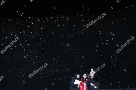 Visitors take a selfie in front of the blackest building in the world in the PyeongChang Olympic park during the PyeongChang 2018 Winter Olympic Games, South Korea, 15 February 2018. The Hyundai Pavilion, designed by architect Asif Khan for the PyeongChang 2018 Winter Olympics, has been coated with Vantablack Vbx2, the blackest pigments ever invented, which absorbs 99 percent of the light that hits its surface.