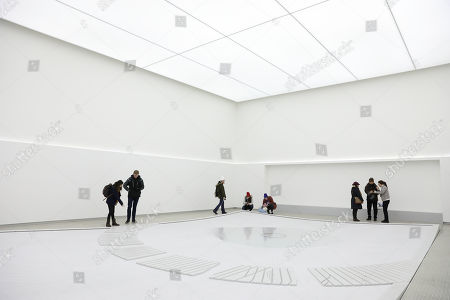 Visitors walk inside of the blackest building in the world in the PyeongChang Olympic park during the PyeongChang 2018 Winter Olympic Games, South Korea, 15 February 2018. The Hyundai Pavilion, designed by architect Asif Khan for the PyeongChang 2018 Winter Olympics, has been coated with Vantablack Vbx2, the blackest pigments ever invented, which absorbs 99 percent of the light that hits its surface.