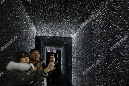 Visitors take a selfie inside the blackest building in the world in the PyeongChang Olympic park during the PyeongChang 2018 Winter Olympic Games, South Korea, 15 February 2018. The Hyundai Pavilion, designed by architect Asif Khan for the PyeongChang 2018 Winter Olympics, has been coated with Vantablack Vbx2, the blackest pigments ever invented, which absorbs 99 percent of the light that hits its surface.