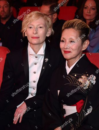 Tilda Swinston (L) and Mari Natsuki sit among the audience at the beginning of the opening ceremony of the 68th annual Berlin International Film Festival (Berlinale), in Berlin, Germany, 15 February 2018. The Berlinale runs from 15 to 25 February.