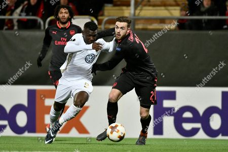 Ostersund's Salisu Abdullhi Gero (L) and Arsenal's Calum Chambers during the UEFA Europa League round of 32, 1st leg soccer match between Ostersund FK and Arsenal at Jamtkraft Arena in Ostersund, Sweden, 15 February 2018.