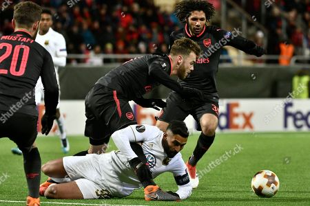 Arsenal's Calum Chambers (C) and Ostersund's Saman Ghoddos (bottom) in action during the UEFA Europa League round of 32, 1st leg soccer match between Ostersund FK and Arsenal at Jamtkraft Arena in Ostersund, Sweden, 15 February 2018.