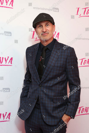 Director Craig Gillespie poses for photographers upon arrival at the premiere of the film 'I, Tonya' in London
