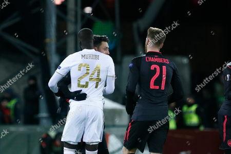 Ronald Mukiibi, Mesut Ozil and Calum Chambers