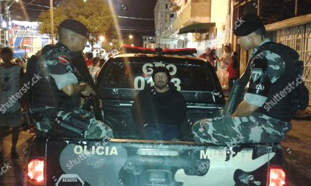 This late photo released by the Military Police press office in Brazil's Para state, shows military police escorting who they identify as Jose Irandir Cardoso in the back of a police truck in Breves, Para state, Brazil. The man convicted in the killing of yachtsman Sir Peter Blake was caught after being on the run for more than 15 years