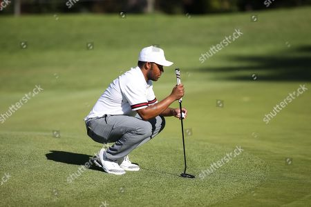 Los Angeles, CA...Harold Varner III, of the United States, looking at his ball before placing it to putt during opening round of the Genesis Open at the Rivera Country Club in Los Angeles, Ca on , 2018. Jevone Moore