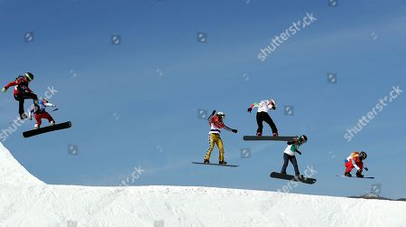 From left; Tess Critchlow, of Canada, Charlotte Bankes, of France, Eva Samkova, of the Czech Republic, Alexandra Jekova, of Bulgaria, Lindsey Jacobellis, of the United States, and Loccoz Nelly Moenne, of France, run the course during the women's snowboard cross semifinals at Phoenix Snow Park at the 2018 Winter Olympics in Pyeongchang, South Korea