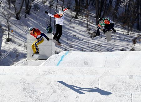 From left; Eva Samkova, of the Czech Republic, Alexandra Jekova, of Bulgaria, and Lindsey Jacobellis, of the United States, run the course during the women's snowboard semifinals at Phoenix Snow Park at the 2018 Winter Olympics in Pyeongchang, South Korea