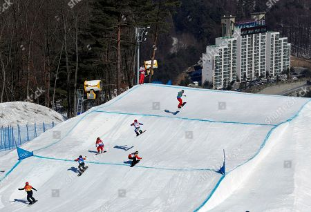 From left; Russian athlete Kristina Paul, Belle Brockhoff, of Australia, Charlotte Bankes, of France, Tess Critchlow, of Canada, Raffaella Brutto, of Italy, and Loccoz Nelly Moenne, of France, run the course during the women's snowboard cross small final at Phoenix Snow Park at the 2018 Winter Olympics in Pyeongchang, South Korea