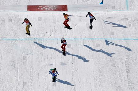 From left; Bronze medal winner Eva Samkova, of the Czech Republic, gold medal winner Michela Moioli, of Italy, silver medal winner De Sousa Mabileau Julia Pereira, of France, Chloe Trespeuch, of France, and Lindsey Jacobellis, of the United States, cross the finish line during the women's snowboard finals at Phoenix Snow Park at the 2018 Winter Olympics in Pyeongchang, South Korea
