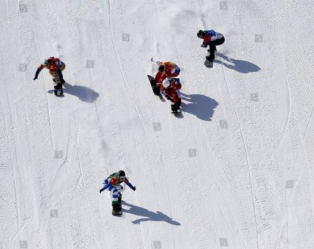 From left; Bronze medal winner Eva Samkova, of the Czech Republic, gold medal winner Michela Moioli, of Italy, Chloe Trespeuch, of France, silver medal winner De Sousa Mabileau Julia Pereira, of France, and Lindsey Jacobellis, of the United States, cross the finish during the women's snowboard finals at Phoenix Snow Park at the 2018 Winter Olympics in Pyeongchang, South Korea