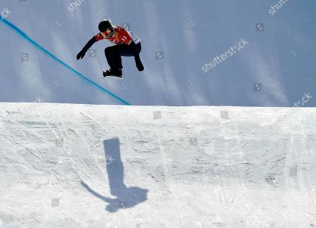 Lindsey Jacobellis, of the United States, jumps during the women's snowboard cross qualifying run at Phoenix Snow Park at the 2018 Winter Olympics in Pyeongchang, South Korea
