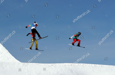 From left; Eva Samkova, of the Czech Republic, Alexandra Jekova, of Bulgaria, and Loccoz Nelly Moenne, of France, run the course during the women's snowboard cross quarterfinals at Phoenix Snow Park at the 2018 Winter Olympics in Pyeongchang, South Korea