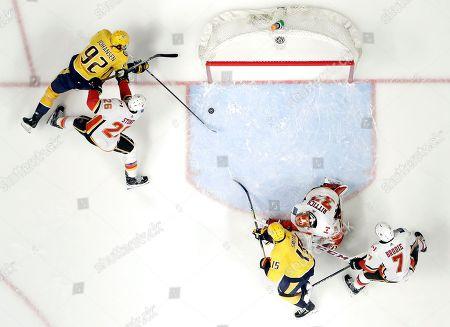 Ryan Johansen, Michael Stone. Nashville Predators center Ryan Johansen (92) scores a goal ahead of Calgary Flames defenseman Michael Stone (26) in the first period of an NHL hockey game, in Nashville, Tenn