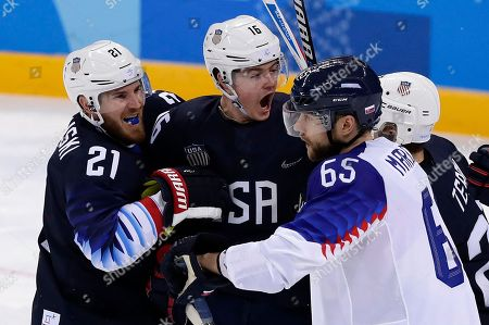 Ryan Donato (16), of the United States, celebrates his goal with James Wisniewski (21) and Troy Terry (23) during the third period of the preliminary round of the men's hockey game against Slovakia at the 2018 Winter Olympics in Gangneung, South Korea