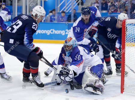 Goalie Jan Laco (50), of Slovakia, blocks a shot by Troy Terry (23), of the United States, during the first period of the preliminary round of the men's hockey game at the 2018 Winter Olympics in Gangneung, South Korea