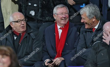 Sir Alex Ferguson [mid] has laugh with fellow director Mike Eddleson [lft] and David Gill [rt]
