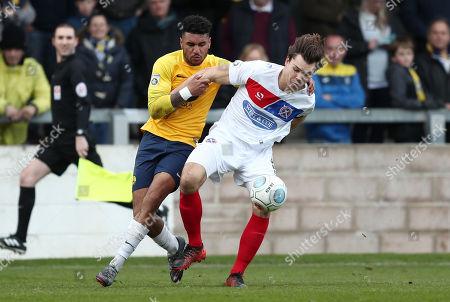 Jamie Reid of Torquay United battles for the ball with Craig Robson of Dagenham & Redbridge