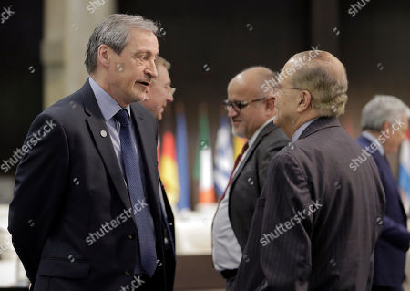 Stock Image of Johannes Hahn, left, European Commissioner for European Neighbourhood Policy and Enlargement Negotiations speaks with Ioannis Kasoulides Minister of Foreign Affairs before the informal meeting of the EU foreign ministers in Sofia